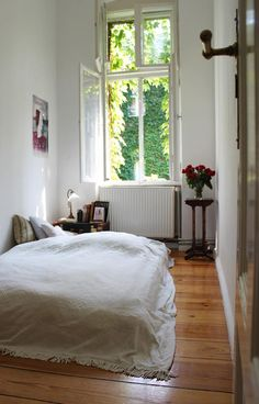 Making the most of a tiny room. Pretty green view and Aesthetic Movement table.