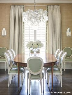 grasscloth wallpaper, dining room chairs.