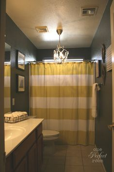 gray, white and yellow bathroom.