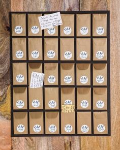 The bride's sister created a message board with 30 mini envelopes to hold well-wishes from guests; Sarah and Kelly plan to read one a year for the next three decades of their marriage.