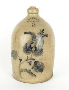 Pennsylvania two gallon stoneware jug, 19th c., impressed M & T. Miller Newport, with cobalt tulip decoration