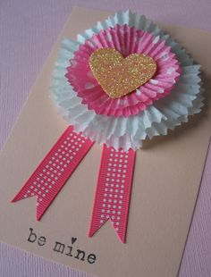 Materials:    Cupcake liners in assorted colors and sizes  Pinking shears (optional)  Double-sided tape or quick-setting craft glue  Heart punch or template  Fine glitter  Ribbon  Pin backs or small, flat magnets  Plain cardstock  Ruler and craft knife (or a paper trimmer)  Valentine stamps  Ink. Of course these wil be made by me:)