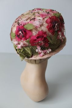 1960's straw cloche with pink flowers and green velvet sash (back view) | Light pink straw hat with a short brim. Light green netting overlay
