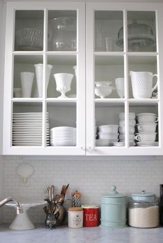 Doors with glass insets in this small kitchen makeover by Grace Happens