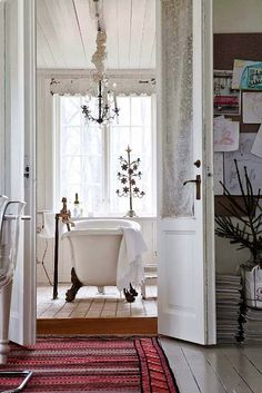 A Swedish country-style Christmas. Great look into a bathroom with a white clawfoot tub.
