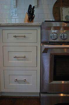 VREELAND ROAD: Client Kitchen. Paint is Ben Moore Mascarpone. Hardware is Lugarno from Restoration. Love the color