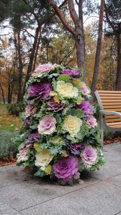 Flower tower using flowering cabbages. Plant cabbage flowering kale in June/early July. A great way to bring color to the fall garden & the edible leaves make a nice garnish on the autumn table...