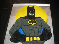 I made this batman cake for my son's 8th birthday, since he LOVES batman.  I rented a batman cake pan from the county extension office.  I outlined his ab muscles and chest w/ a round #5 tip, w/ black then i used a star tip size 18 for all the grey and rest of black.  I used white for the eyes and face, and w/ a knife i frosted the yellow background and the blue, and his belt.  Turned out really well and my son loved the cake!