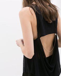 elegant   black cut-out shirt, thin chain