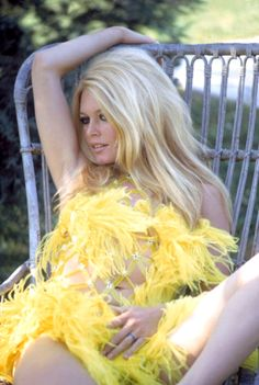 Brigitte Bardot in yellow feathers.