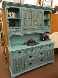 SOLD - Shabby turquoise sideboard with hutch top - 5 drawer and 2 cabinets in base - 3 small drawers, 1 cabinet and 2 open displays on top - painted, distressed and antiqued.  ***** In Booth H12 at Main Street Antique Mall 7260 E Main St (east of Power RD on MAIN STREET) Mesa Az 85207 **** Open 7 days a week 10:00AM-5:30PM **** Call for more information 480 924 1122 **** We Accept cash, debit, VISA, MasterCard or Discover.