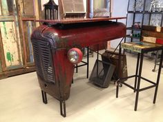 A table made out of an old tractor bonnet, creative mind who thought of this! #DIY   WOULD BE CUTE IN HUBBY'S SHOP!