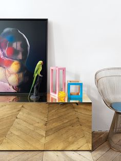 Mirrored gold credenza, eclectic styling, Platner Arm Chair from Knoll
