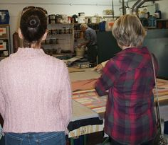 Behind the Scenes at Beckford Silk: visitors watch James making up a batch of dye.