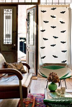 This simple bat-patterned curtain via Design Sponge is a cute backdrop for a party.