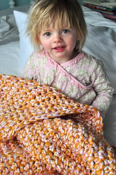 Simple beginner baby blanket: Three different colors of yarn all used together (only uses a single crochet... super easy)