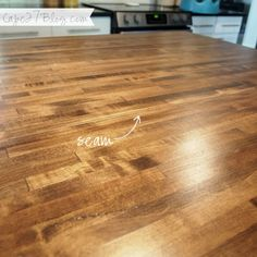 we purchased two separate pieces of butcher block from Lumber Liquidators, each 25″ x 8′.   After cutting them to size at 25″ x 6'2″ (make sure you have a sharp blade, the butcher block is very dense) we drilled pilot holes on an angle from beneath the countertop with a 3/16 inch counter-sink bit. To combine the two pieces we used several 3-inch wood screws to secure a nearly seamless countertop.