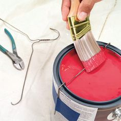 Use a hanger to prevent drips off a paint can