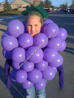 Homemade Bunch of Grapes Halloween Costume: This homemade bunch of grapes Halloween costume is the easiest and the cheapest costume I have ever made!  The best part is it only took about half an
