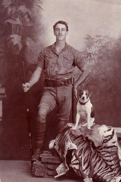British man posing with dog and rifle, Bangalore, India, circa 1910