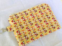 Golden Little Foxes Small Zippered Pouch by pogtotes on Etsy, $9.95