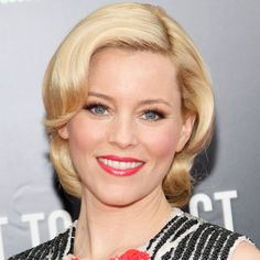 We love how Elizabeth Banks keeps a modern edge with a bright pink lip to this classic old Hollywood look.