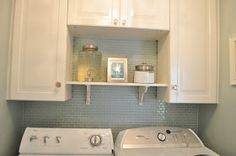 Love the shelf between the cabinet. And the detergent in the dispenser....CUTE!!!!
