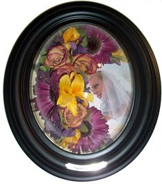 8 x 10 SIT46  Black.  Combine a photo with flowers from the bouquet or table arrangements.  This type of arrangement works for any occassion from birth of a baby to first recital to funeral tribute.  $200 includes preservation of your flowers, inclusion of photo or other items, all labor, and frame.  Click for more ideas and color selections.