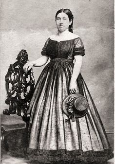 Woman in dotted sheer dress with ruched trim, mid-19th C.