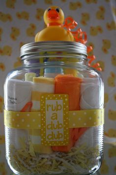 Bath Time in a Jar  ~     Fill a large glass jar with cute baby washcloths, onesies, travel size baby wash, shampoo, lotion, powder, Q-tips, & rash cream. A gift card would add a nice touch too. Glue a rubber ducky to lid and add polka dot ribbon  around jar. Print color-coordinated tag for front of jar. Great baby shower gift.