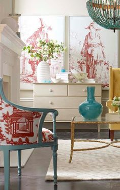 Vignette - Turquoise chair with red upholstery, white cabinet with red lithos on wall...chic.