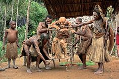 The Kuku-Kuku people of Aseki in Papua New Guinea embalm their deceased by smoking the corpses. They use the very bamboo frame that supported the body while it hung roasting over the flames to carry it to the cliff top then the frame goes on supporting the mummified body as it gazes upon the village.  The practice still endures.