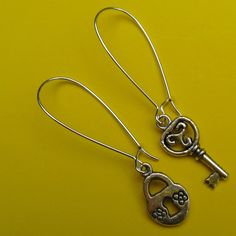 Lock and Key Earrings on French wires.  Love THESE! $7.00.  http://www.etsy.com/listing/104027186/lock-and-key-earrings?ref=shop_home_active