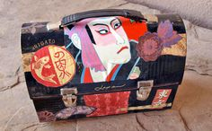 Old lunch box painted and collated with a Japanese theme. This box is painted a red lacquer on the inside and makes a wonderful purse.