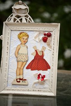 Framed paper dolls - would be cute in my daughter's room!
