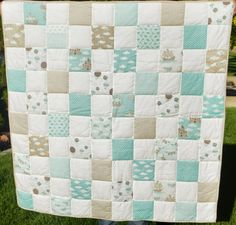 Patchwork baby boy quilt made out of Moda fabric line Storybook by Kate and Birdie.