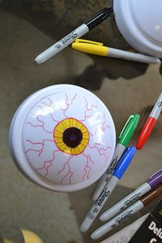 halloween diy -- east project to make glowing eyeballs.  just buy cheap touch lights(at dollar store) and draw eyeballs on them with permanent markers.