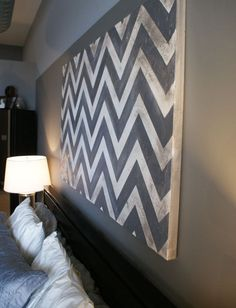 Vintage chevron wall art for above bed.