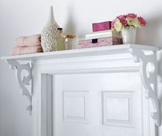 Functional Over-The-Door Shelving  Use vertical space to store and display.