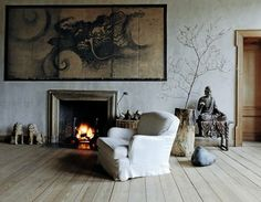 Love the elements here.  What a beautiful collection and how interestingly displayed.  SIMPLE. Like the idea of no rug but...having one would be nice as well