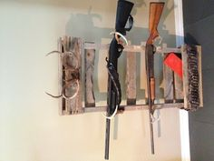 Gun Rack made from pallets and deer antlers.. Boxed shelf on bottom to hold shells and cleaning kit...