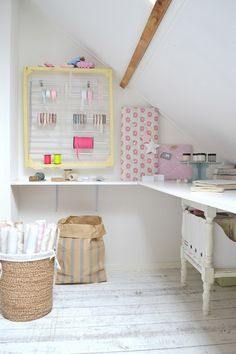 Clever framed ribbon storage in attic craft room & tilda covered notice boards