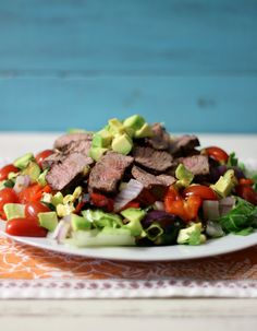 Grilled Vegetables and Tri-Tip Salad - A healthy, summer time grilled salad, made with zucchini, corn, peppers and onions, topped with sliced tri-tip steak and drizzled with lime juice.
