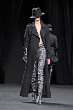 A.F. Vandevorst inspired by Pina Bausch | Fashion Week – Paris 2012  long coat, trousers, no top one glove, hat- playing with how much of the body is covered.