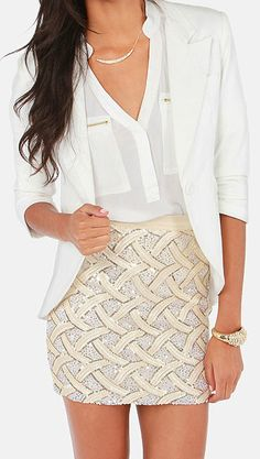 Cream Sequin Skirt with tucked in sheer shirt. White blazer on top. Is sexy and classy. shows off hourglass figure