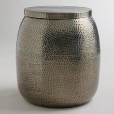 From WorldMarket.com: Cala Hammered Drum Table