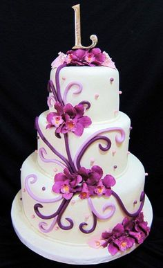 Purple wedding cake with orchids.