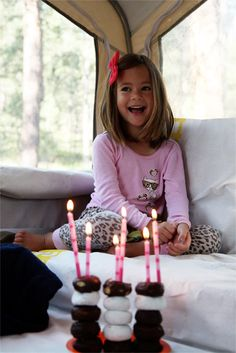 love the stacked donuts with candles for celebrating! (don't know the little girl!)