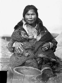 Inuit woman nursing twins.