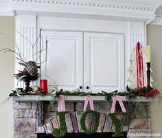 Joy Christmas Mantel with Grain Sack Tree and evergreen and holly